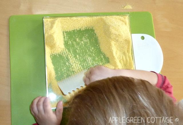 sensory activities for kids - corn meal