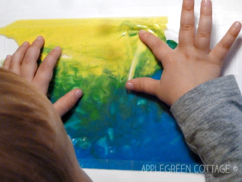 no mess finger painting with ziplock bag on a window