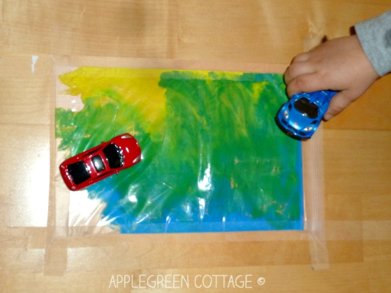 mess free finger painting for kids with a ziplock bag on the floor