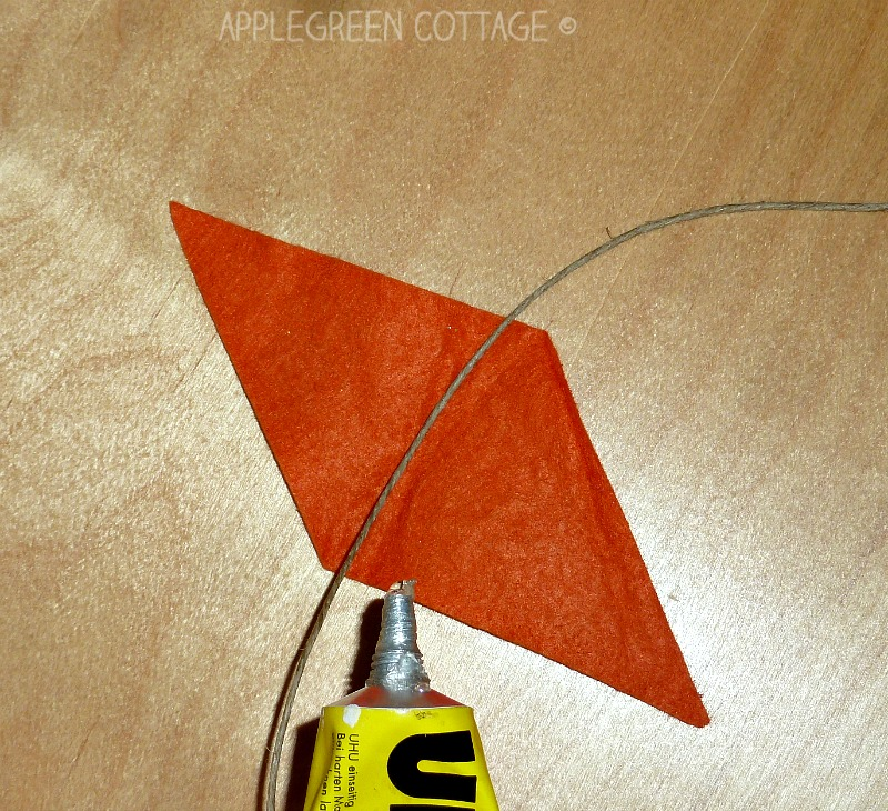 How to make an easy no-sew felt bunting. A great family crafting activity and a DIY decoration, perfect for a birthday or a back-to-school celebration.