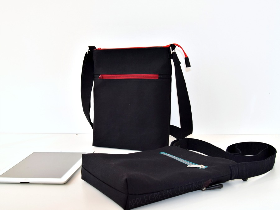 two black crossbody bags on a white surface