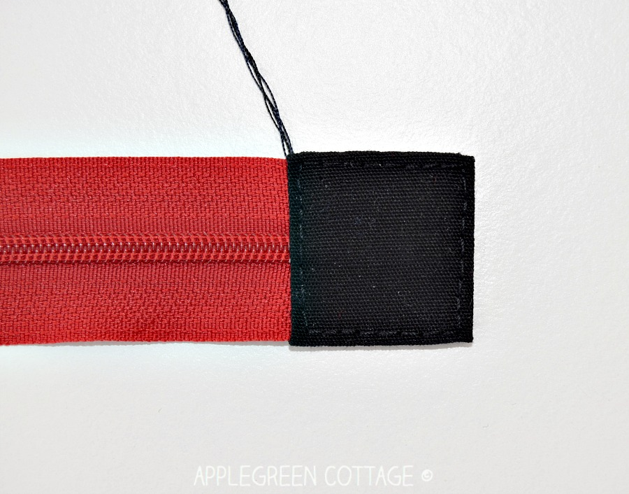 How to sew a zipper tab to one end of a zipper