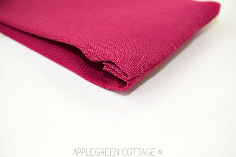 corner sewing detail on pink fabric