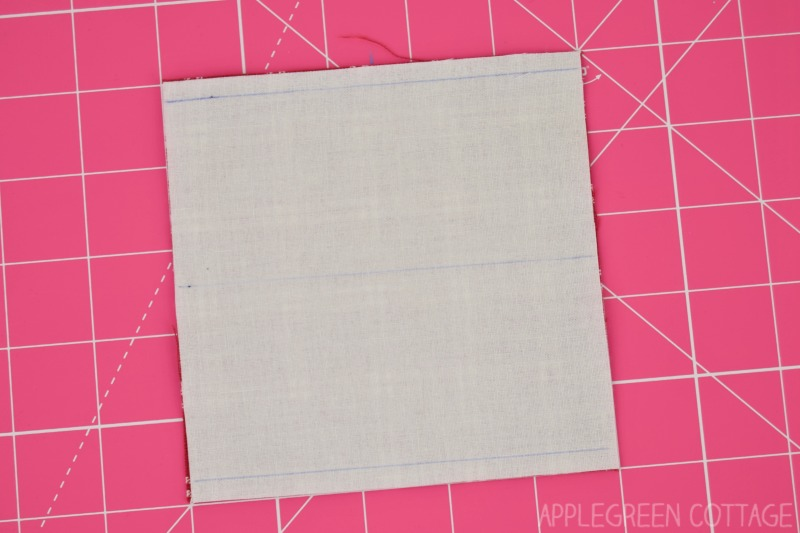 four patch marking on a square quilt block