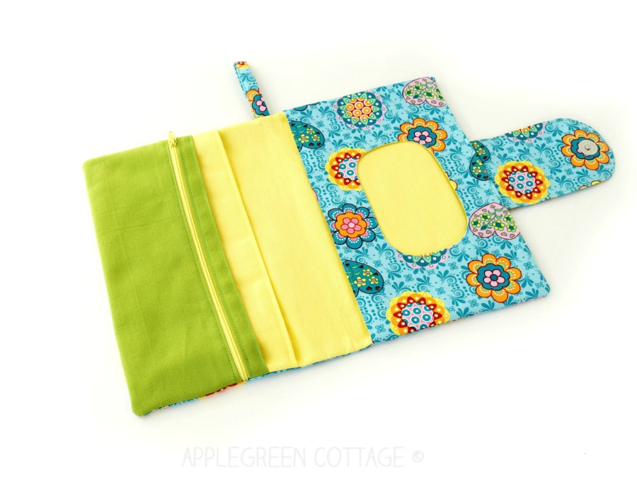 pocket with opening on diaper clutch