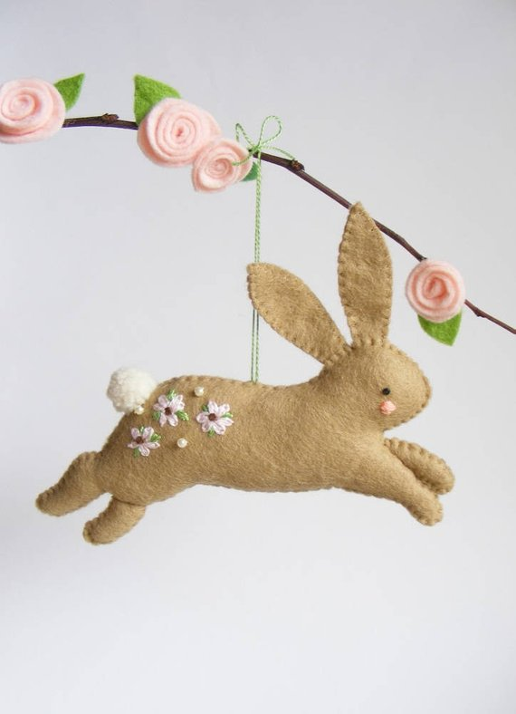 diy felt bunny hanging from a branch
