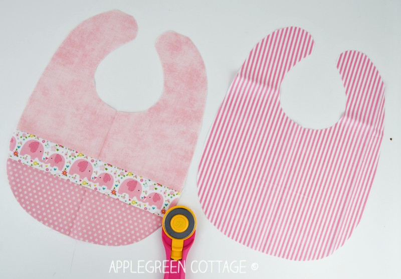 two pieces of fabric cut from the baby bib pattern