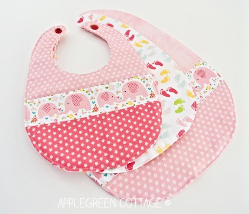 three pink bibs sewn with free baby bib pattern