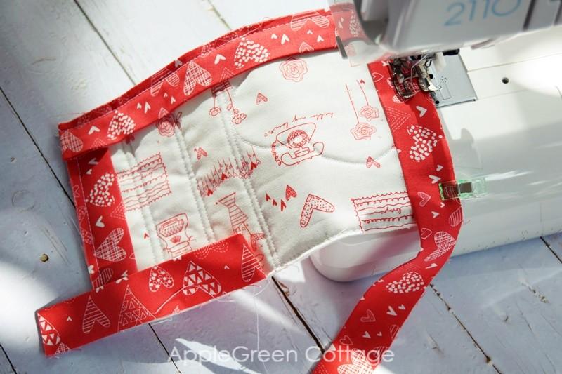 add binding and mitered corners to mug rug