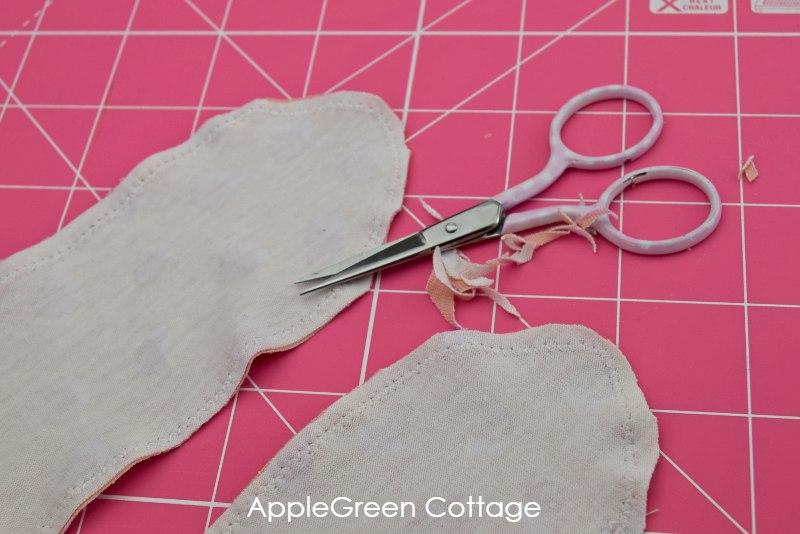 scissors trimming the sewn headband
