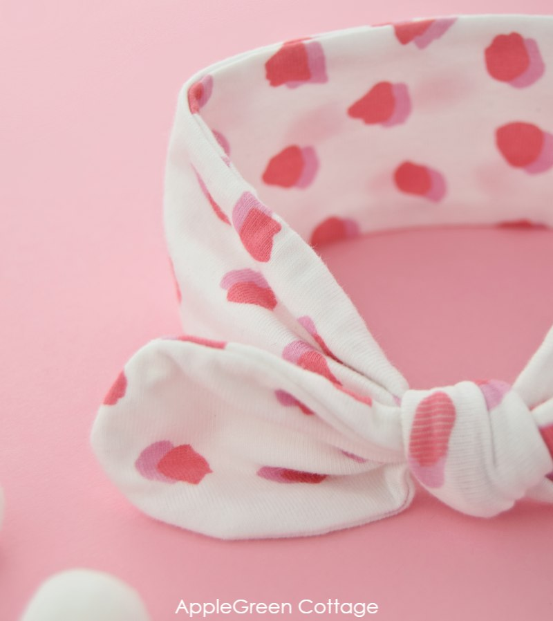 white baby headband with spot print on jersey