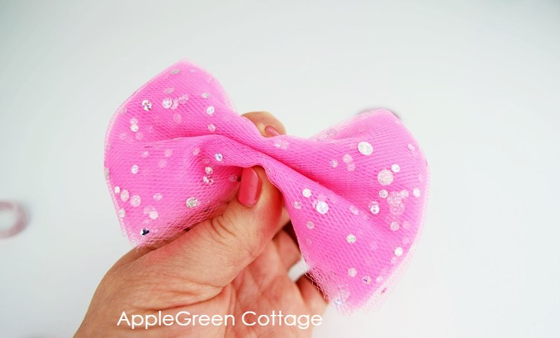 diy pink tulle bow pinched in the middle