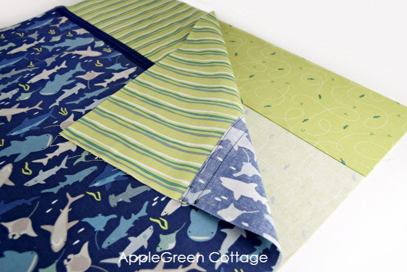 stacking fabrric layers to sew an envelope pillowcase