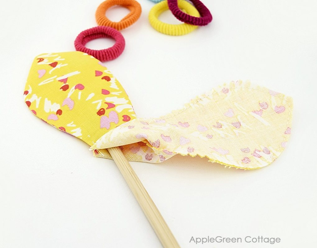 fabric project being turned right side out with a chopstick