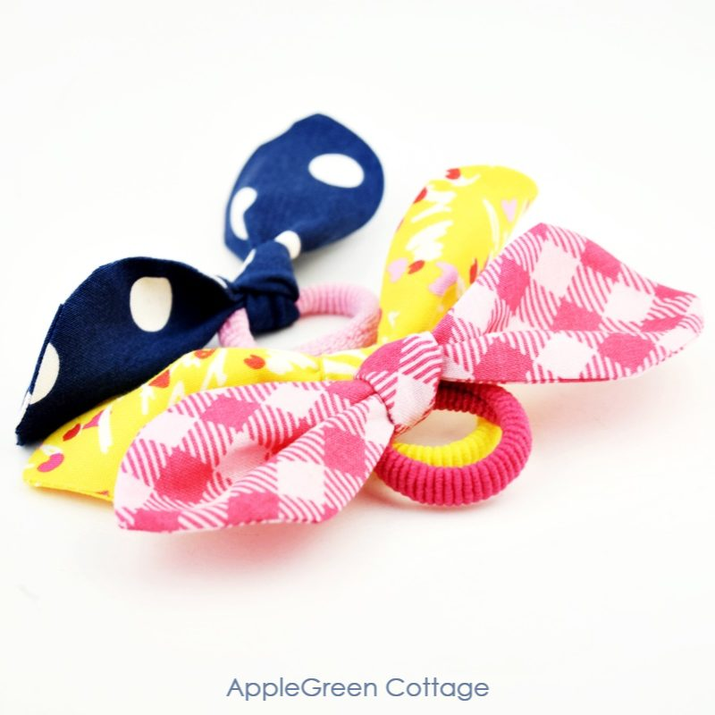 fabric knot bow hair ties in yellow, pink and blue colors