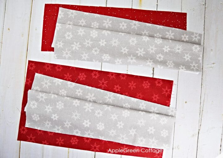 red and grey fabric pieces to sew a pillow