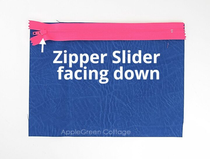 sewing zipper to blue fabric