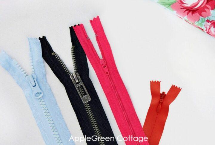different types of zippers shown on a white surface