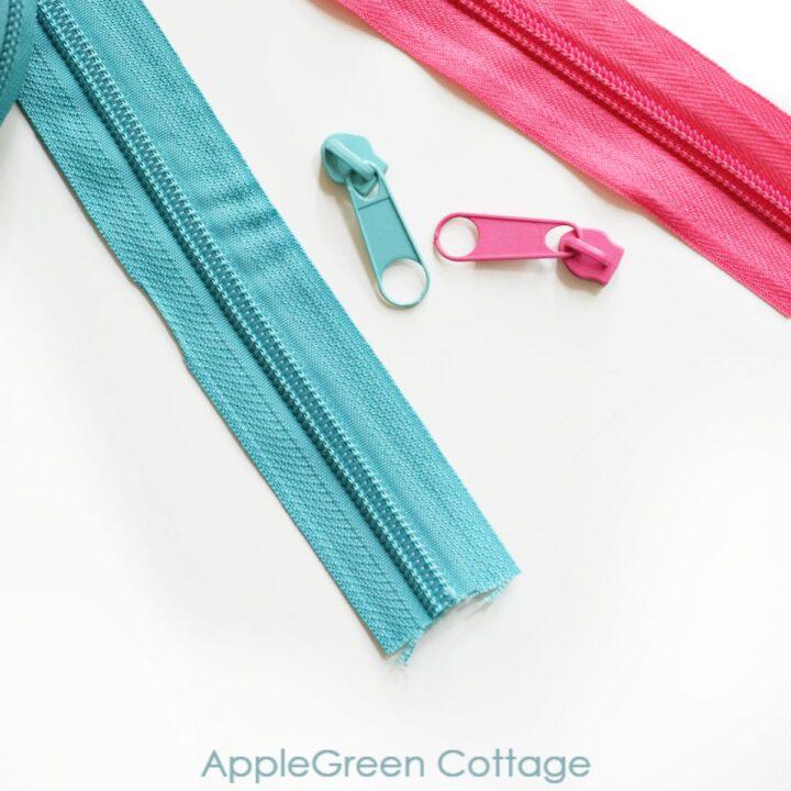 installing a blue zipper head on a blue zipper tape and a pink zipper tape with a pink zipper slider