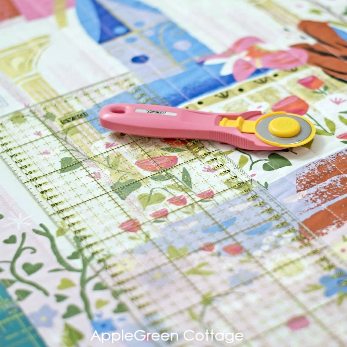 quilted fabric panel and squared up with a pink rotary cutter and quilting ruler