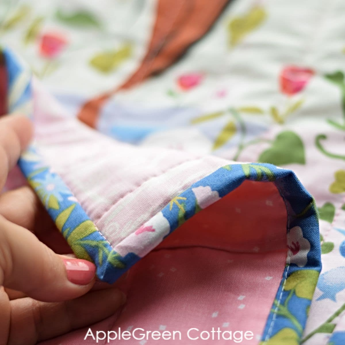 sewing binding on a panel quilt