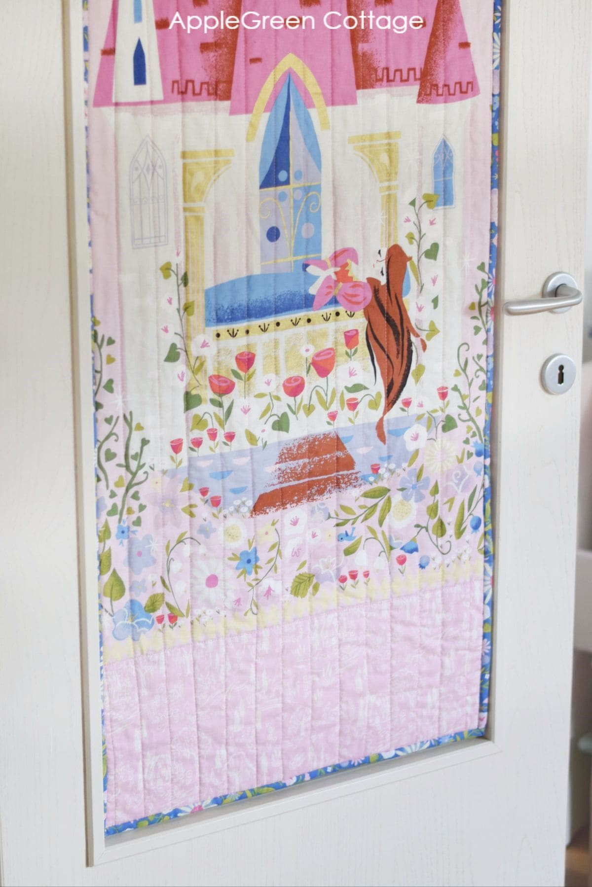 a finished panel quilt with binding in blue floral print